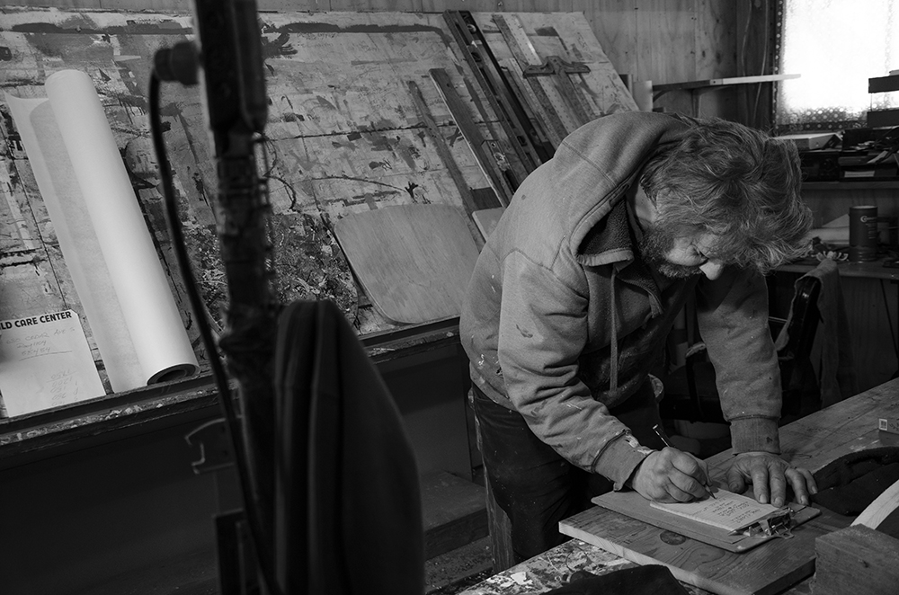 Phil sketching letters in his garage and studio // Photo by Aaron Job