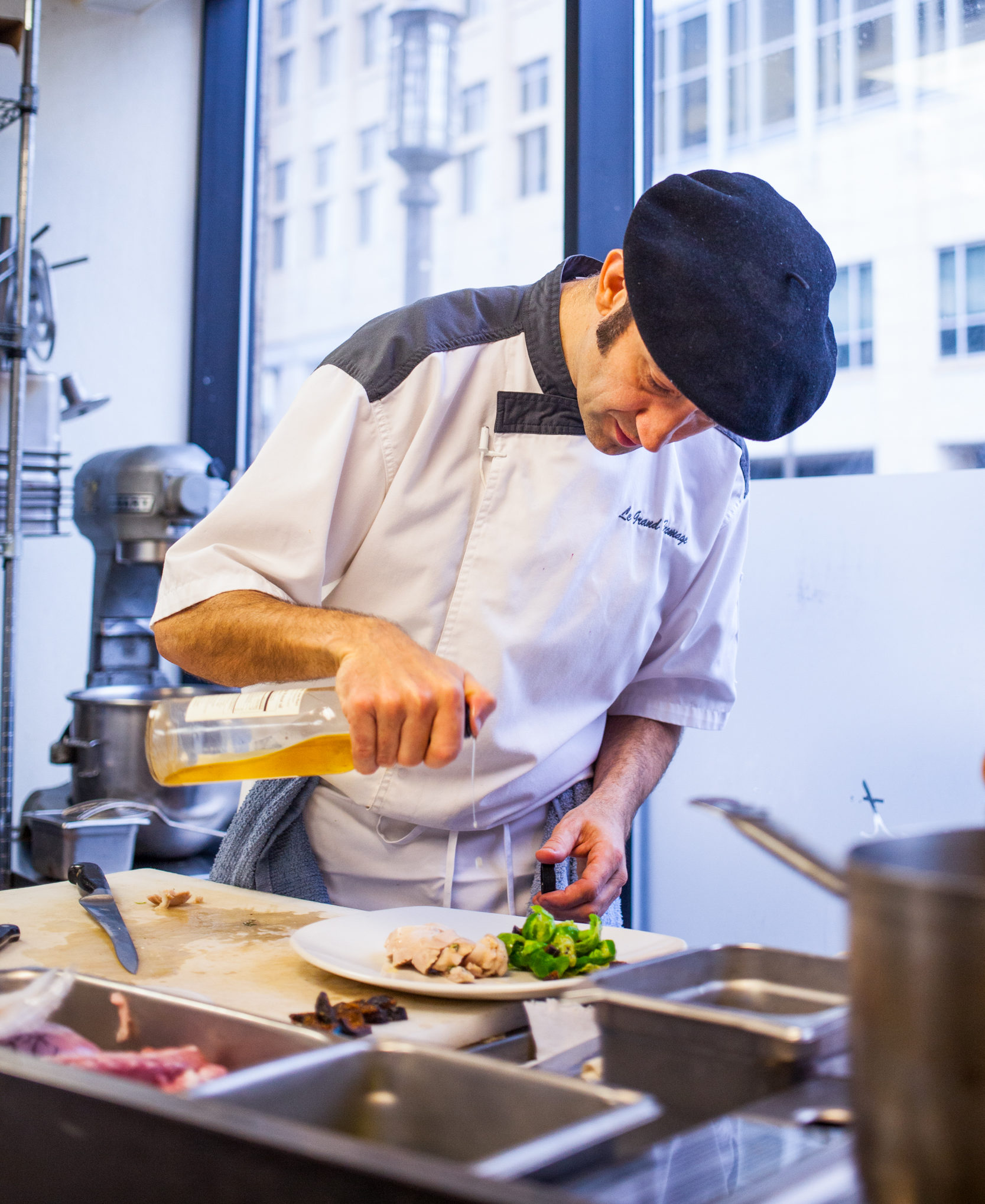 Vincent Francoual prepares a dish // Photo by Tj Turner