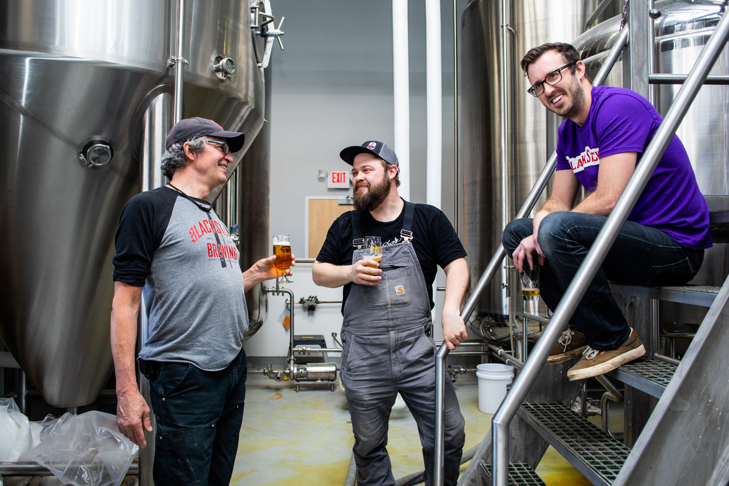 Bob DuVernois with Cooper Johnson and Mat Waddell in the brewhouse at BlackStack Brewing in St. Paul // Photo by Tj Turner