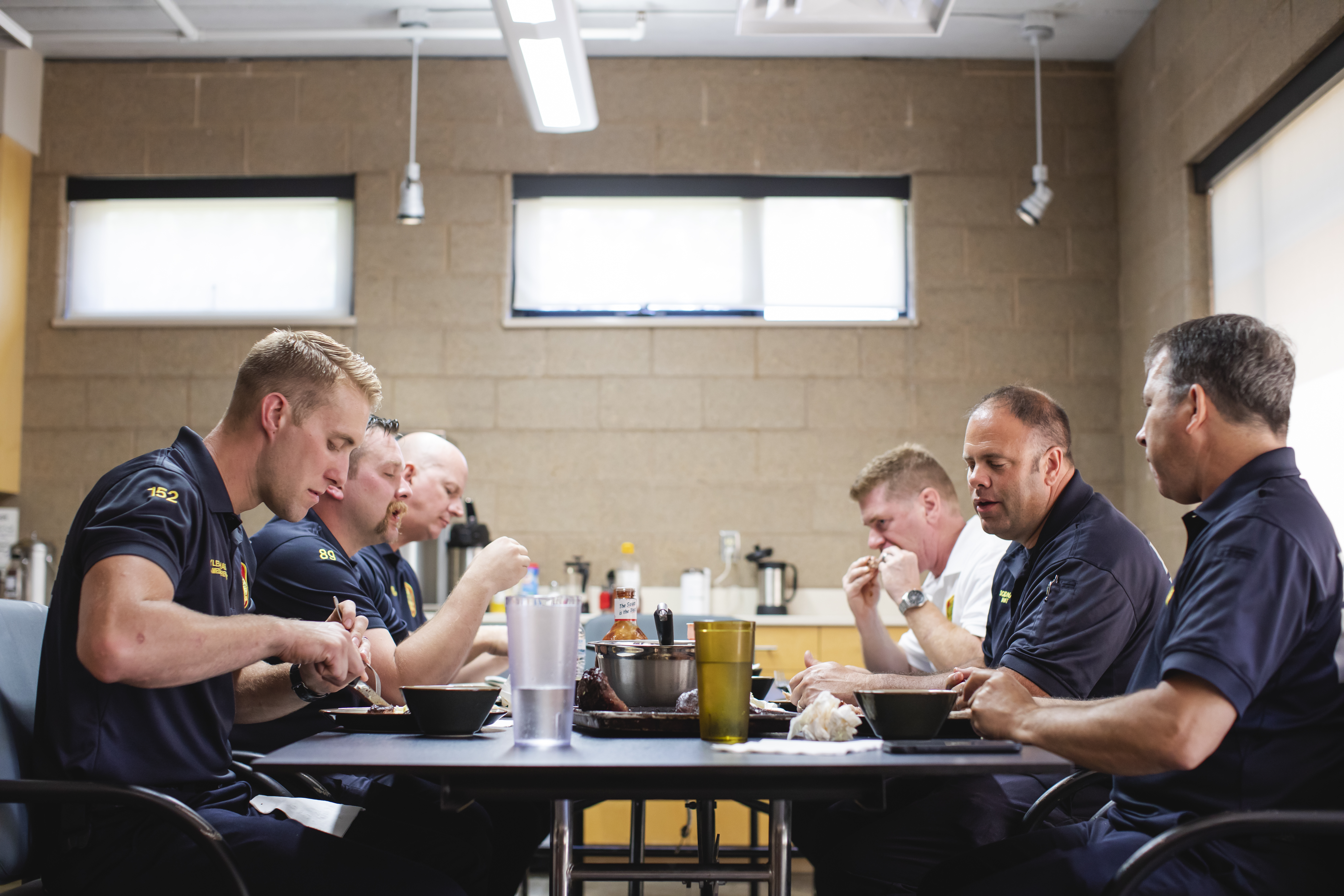 The crew at Edina Fire Station 1 sitting down for a meal // Photo by Garrett Born