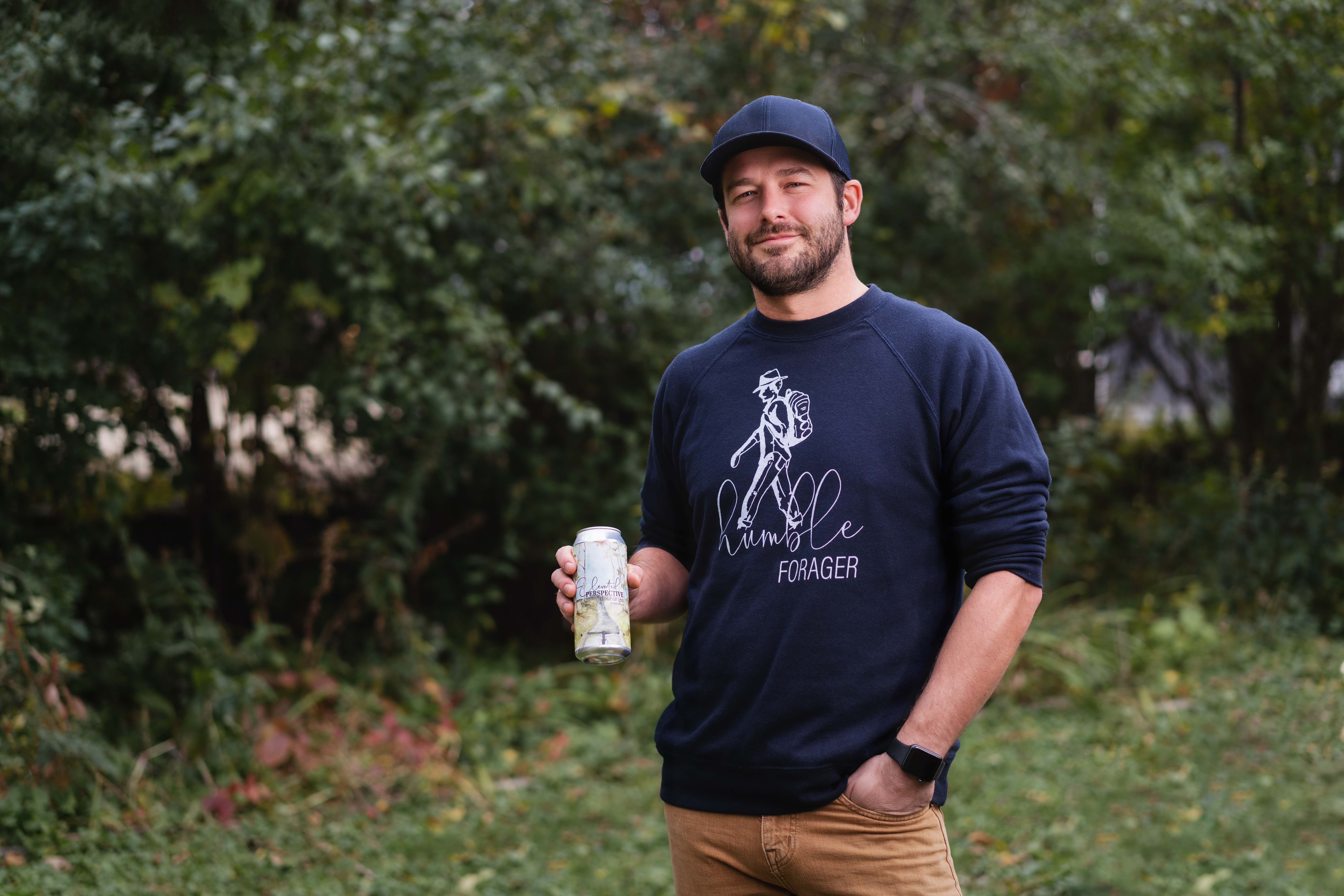 Austin Jevne, co-owner of Forager Brewery in Rochester, poses with a can of their new distribution beer brand, Humble Forager // Photo courtesy of Humble Forager Brewery