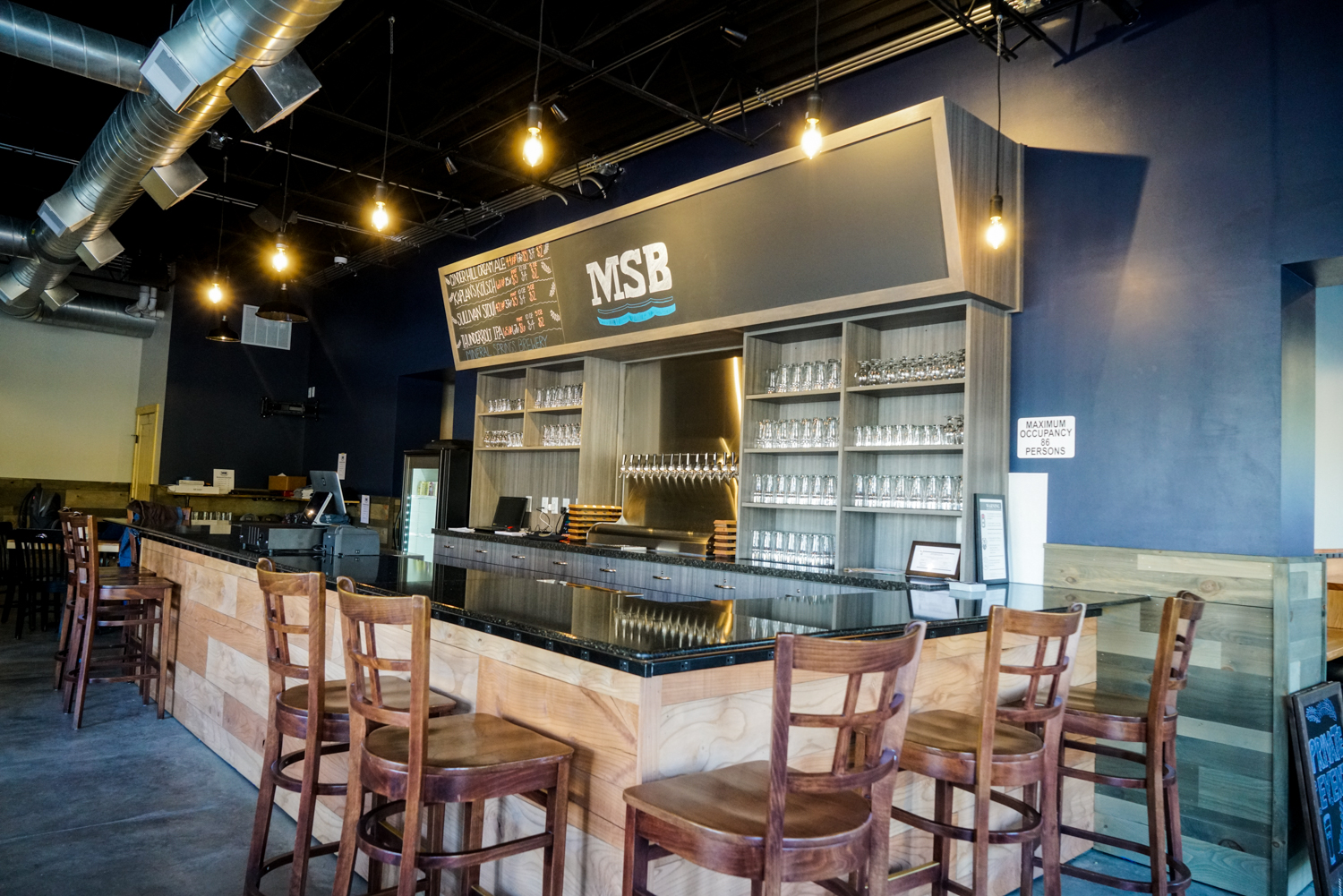 The bar in Mineral Spring Brewery's taproom in Owatonna // Photo by James Figy