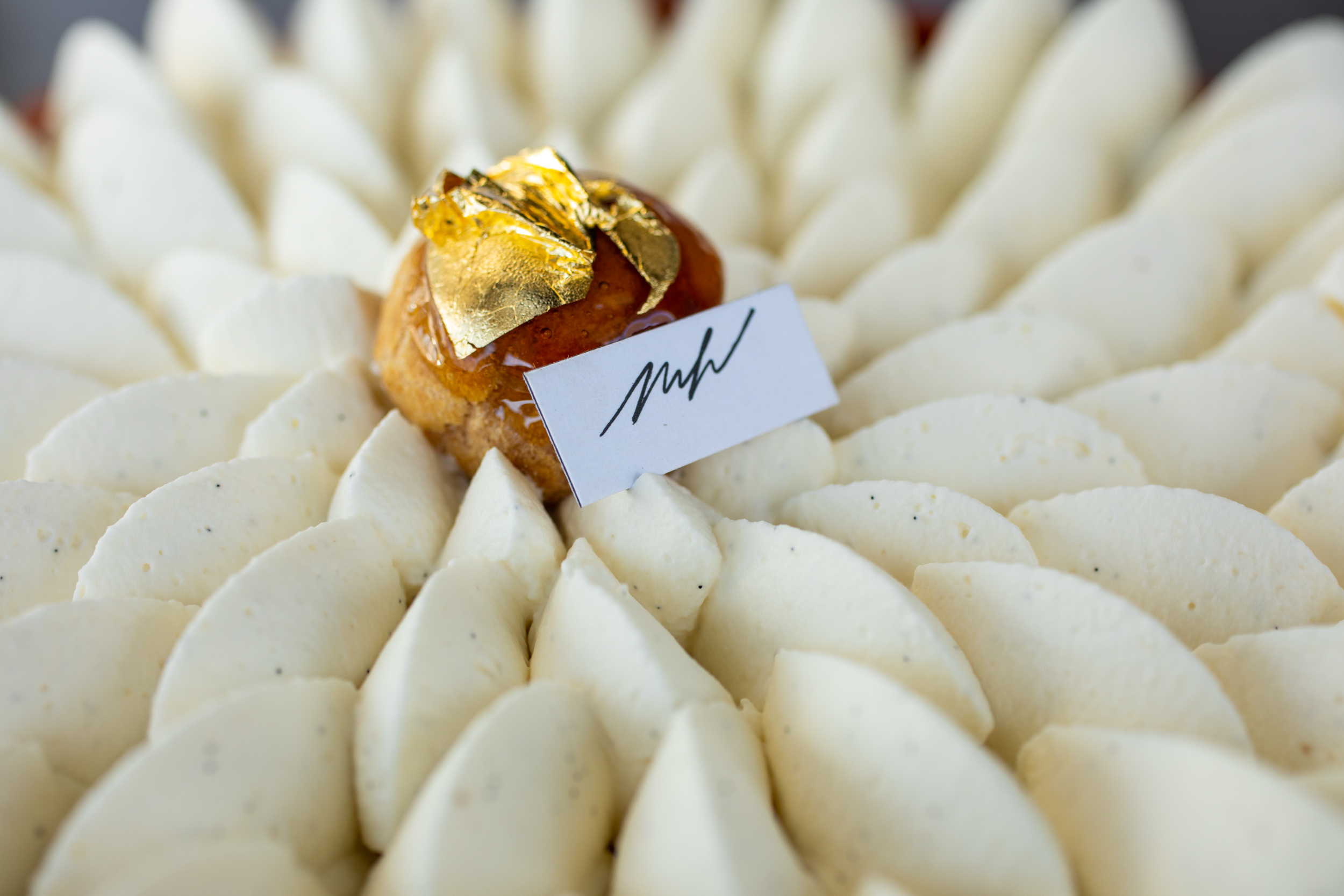 Vanilla Saint Honore topped with a perfect caramel-covered cream puff with 24k gold leaf // Photo by Tj Turner