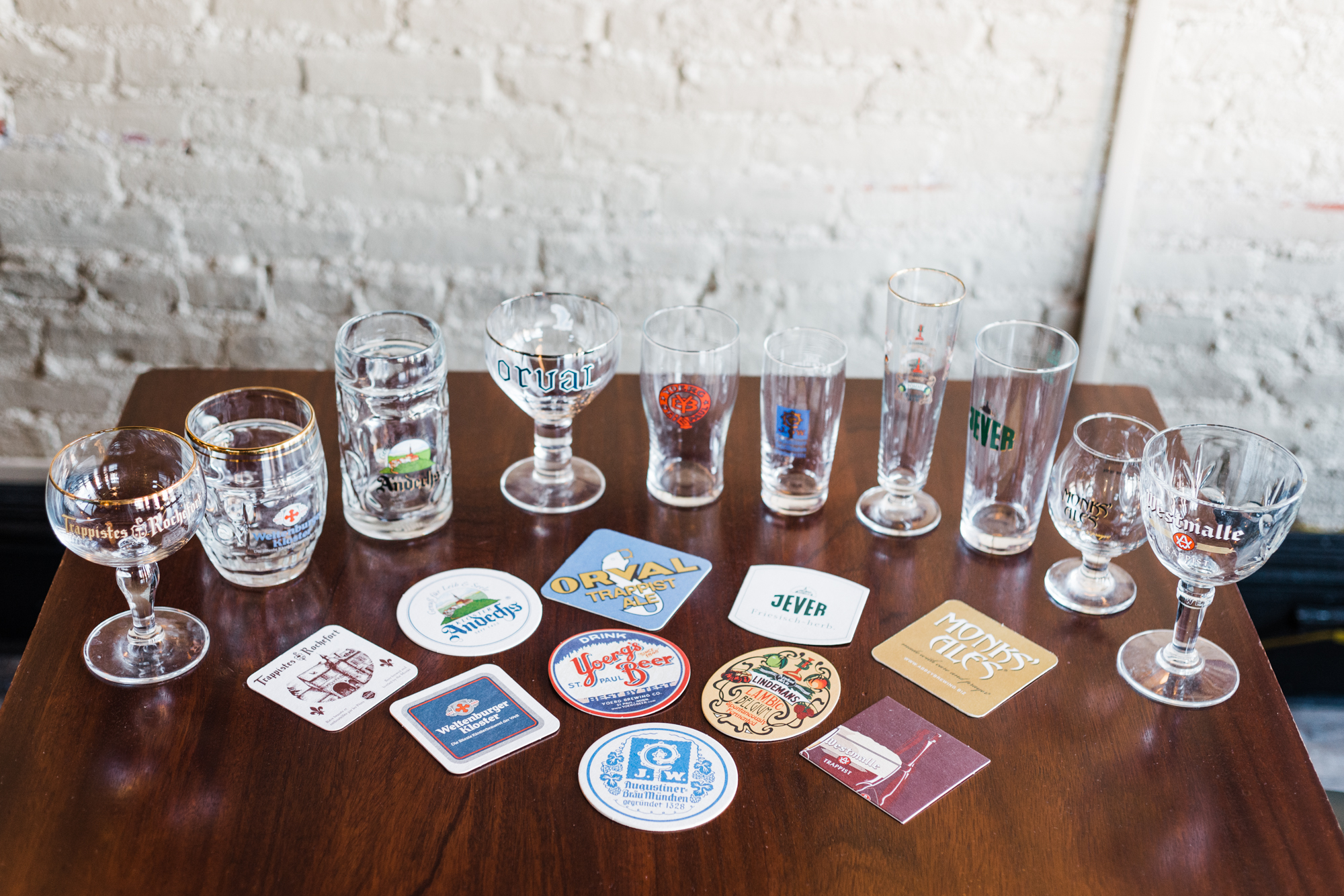 Glassware and coasters for each brewery poured at Yoerg. Each beer must be poured in the proper glass and paired with the proper coaster. Photo by Katelyn Regenscheid
