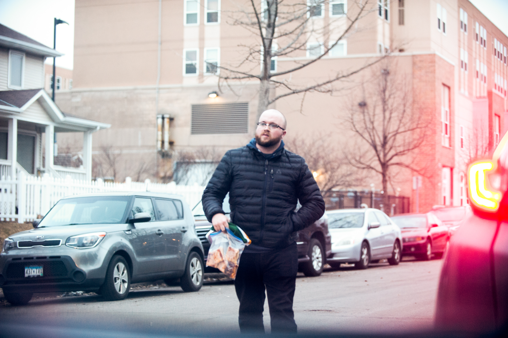 Writer Eli Radtke picking up a bag of Pâté chaud (or bánh patê sô) purchased on Facebook Marketplace // Photo by Daniel Murphy