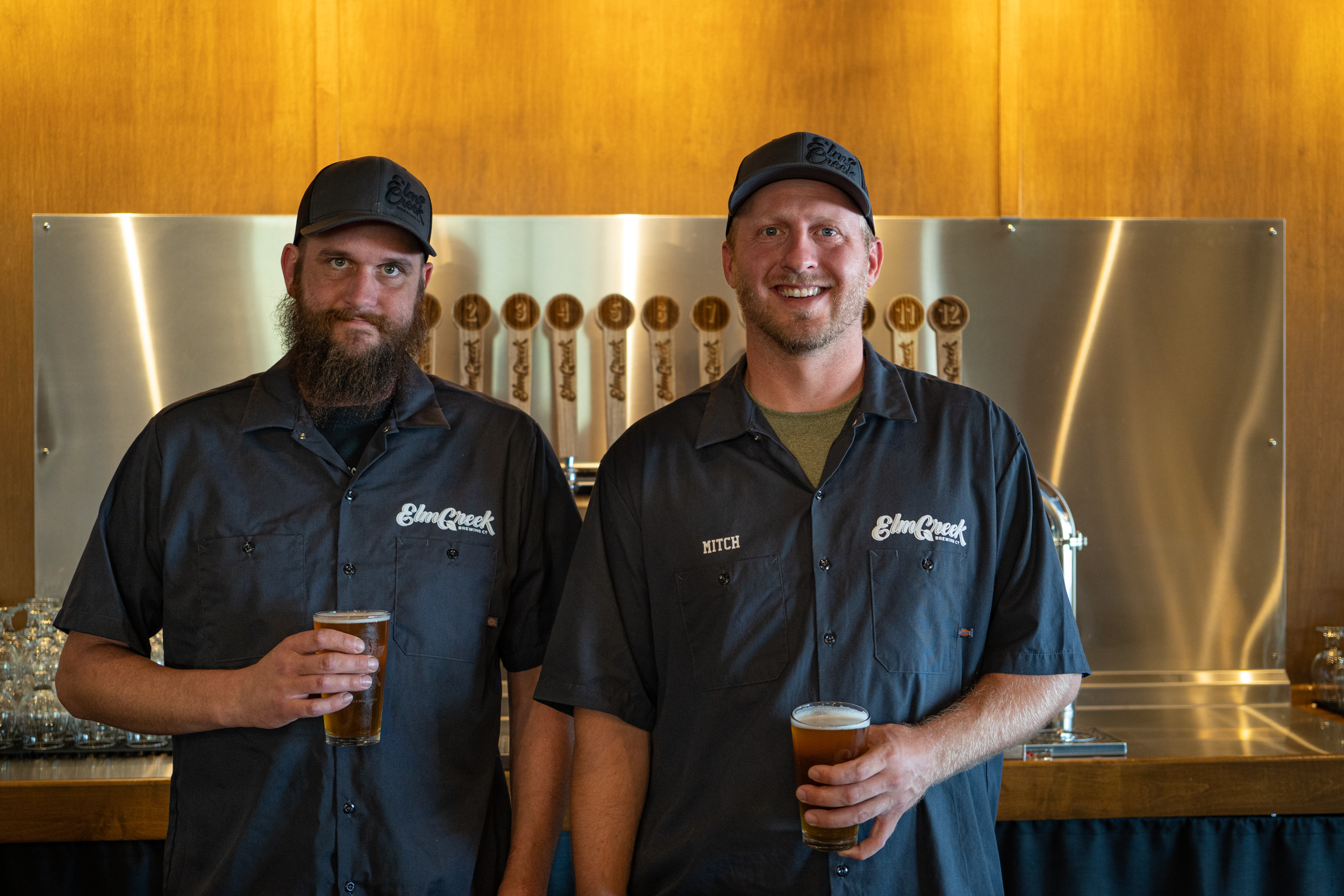 Elm Creek brewer Grant Aldrich (left) and Mitch Carlson, who co-owns the brewery with Wade Carlson // Photo by Tony Saunders