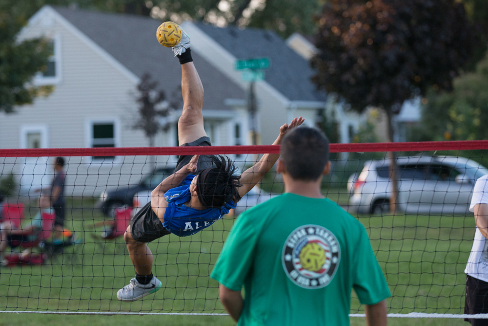 A player connects with the ball on a rolling spike // Photo by Ryan Siverson