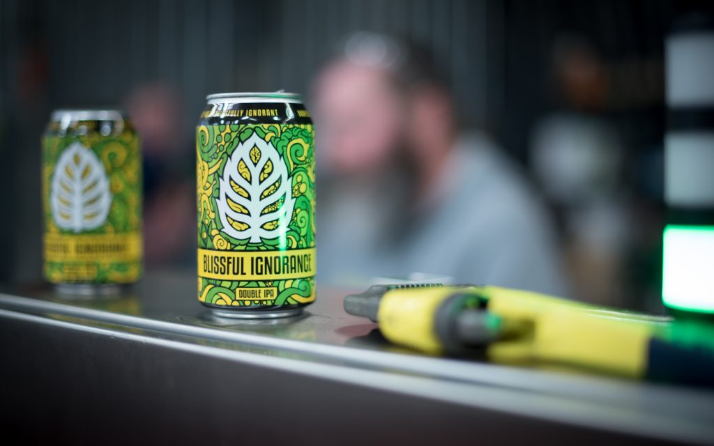 Lupulin Blissful Ignorance in cans // Photo by Kevin Kramer