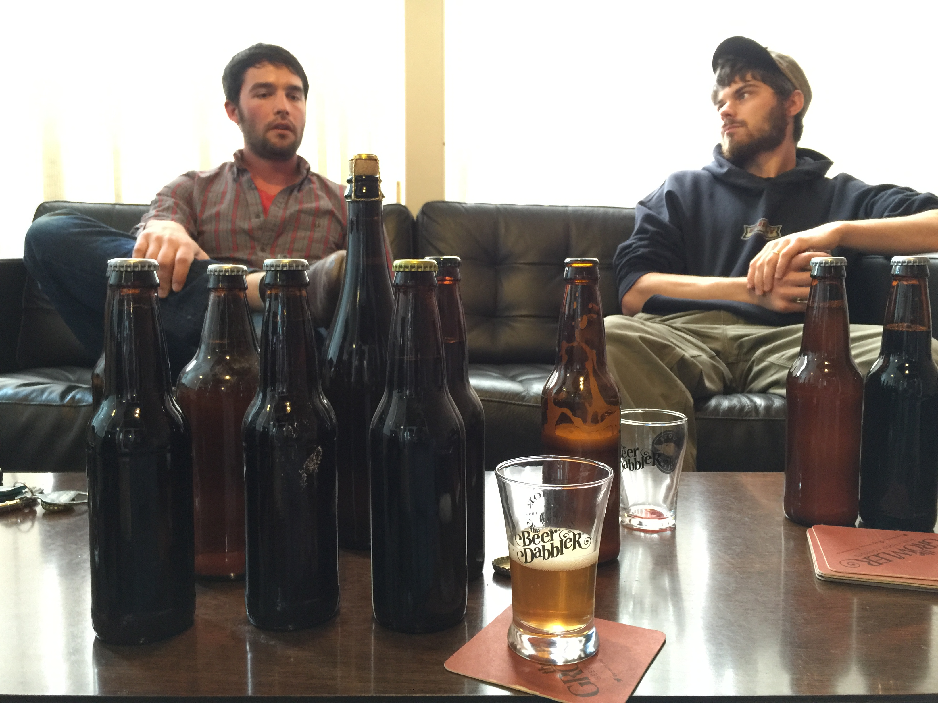 Oakhold founders Levi Loesch, left, and Caleb Levar sample some of their beers at The Growler editorial office // Photo by Joseph Alton