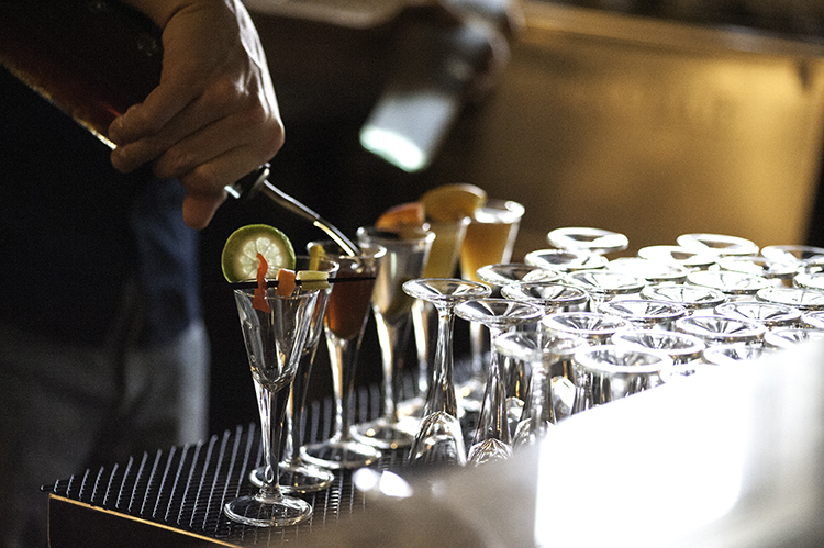 Bartender pouring drinks at Tongue In Cheek // Photo by Daniel Murphy