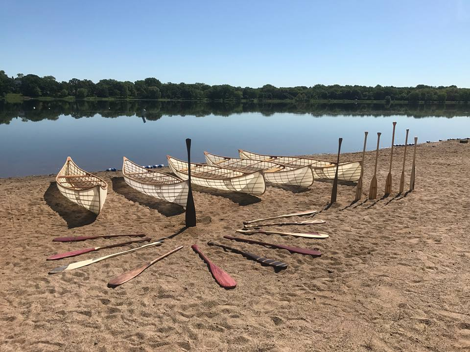 Canoes and paddles built by participants in Urban Boatbuilders' program // Photo via Urban Boatbuilders Facebook