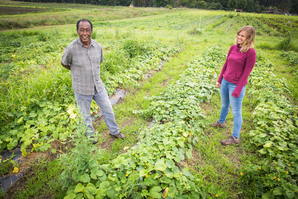 Kano Banjaw and Laura Hedeen walk through a field at Big River Farms // Photo by Aaron Davidson
