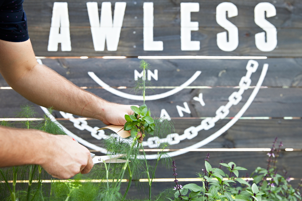 The Garden Sling is a DIY cocktail using fresh cut herbs of the patron's choosing from Lawless Distilling's herb garden // Photo by Katie Cannon