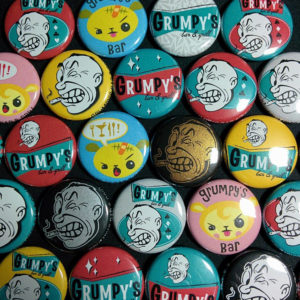 A collection of Grumpy's buttons // Photo via Grumpy's in Roseville Facebook