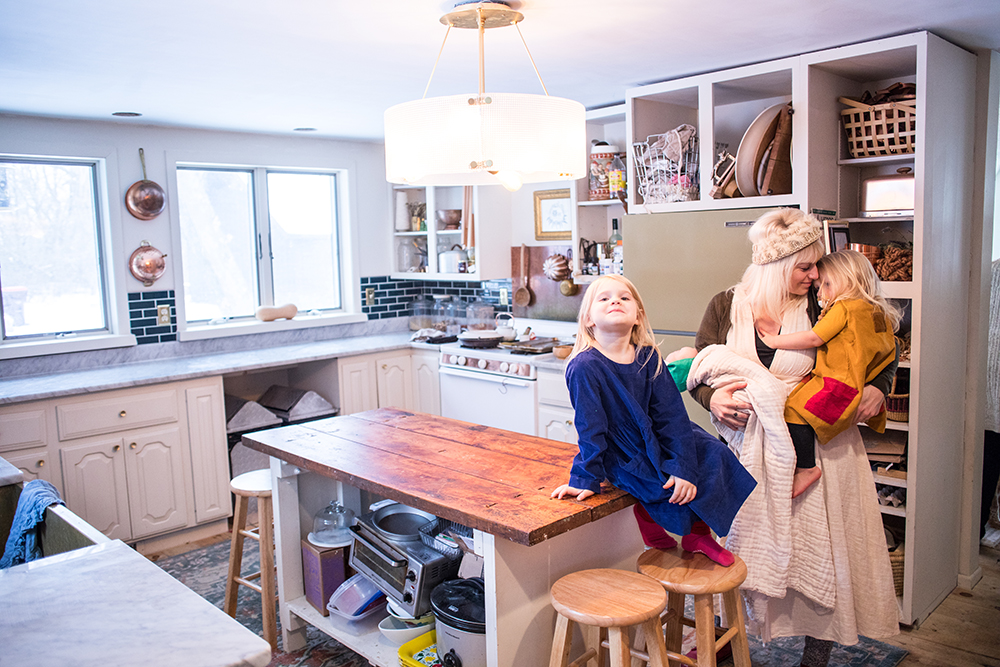Johnna Holmgren with her children; five-year-old Luella, in blue, left, two-year-old Minoux, in yellow, right, and three-month-old Juniper // Photo by Tj Turner