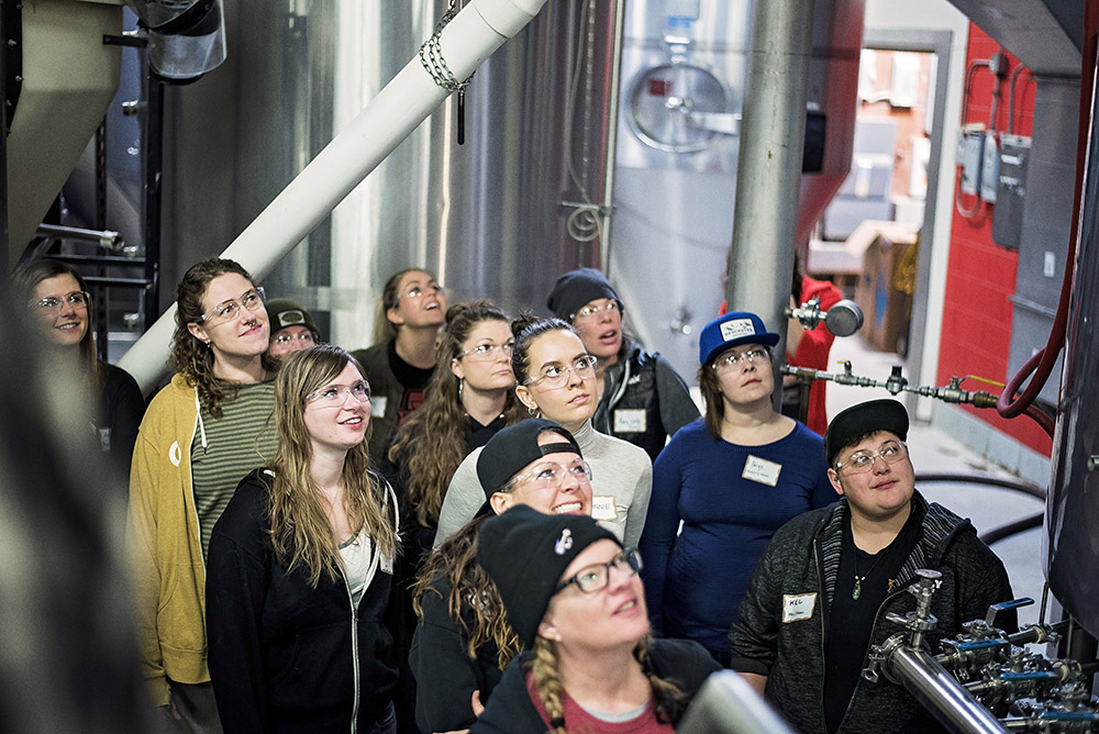 Some of the Witch Hunt Brew Day 2018 participants look on as they learn about the history of women in beer and brewing // Photo by Madalyn Rowell