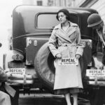 People applying bumper stickers advocating for the repeal of the 18th Amendment // Photo courtesy Minnesota Historical Society