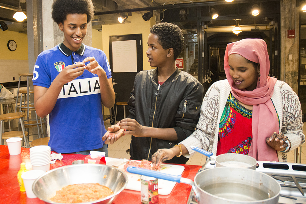 "Somali high school students who participated in the MNHS program ""Wariyaa: Somali Youth in Museums"" in 2016 interviewed family members, collected recipes and stories, researched techniques and ingredients and tested recipes at the Mill City Museum Baking Lab // Photo by Andrea Reed, Minnesota Historical Society"