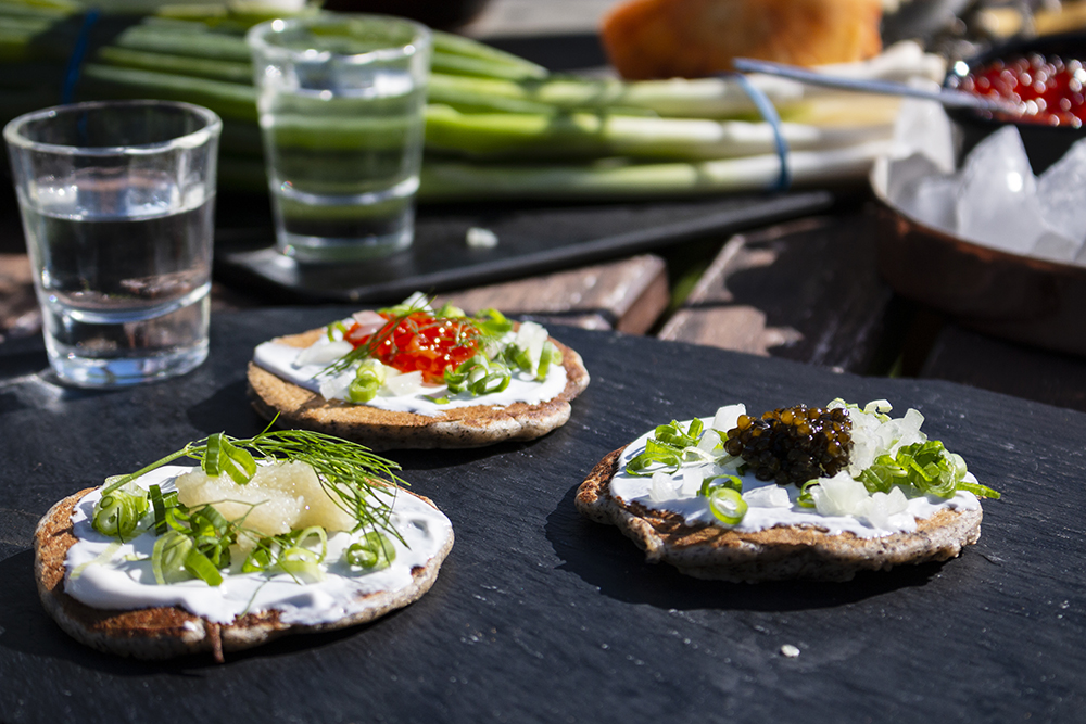 An assortment of blinis with shots of vodka // Photo by Aaron Job