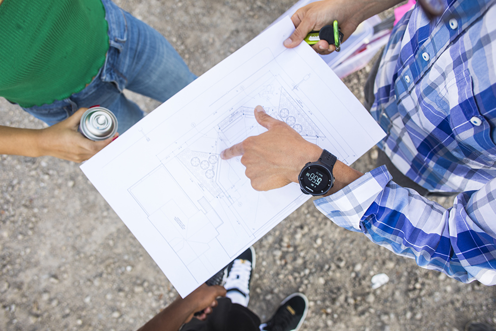 JXTA Arts students review the plans for the new North Minneapolis skatepark and art plaza // Photo by Tj Turner