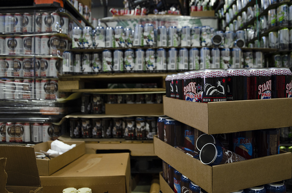 Barley John's has helped bring brands like Duluth Brewhouse and Hunyuck, among others, to market through contract brewing. Here, pallets of each brewery's cans await filling at the Barley John's Brewing facility // Photo by Aaron Job