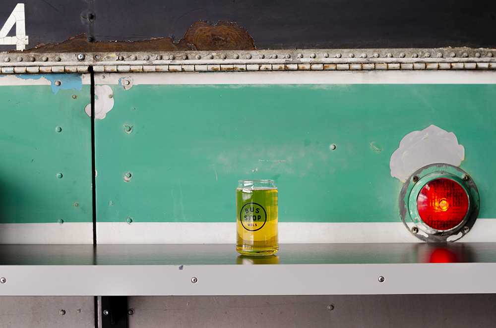 One of the guest beers on tap from a local brewery in a Bus Stop Burgers & Brewhouse glass // Photo by Aaron Job