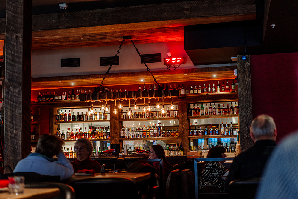 The bar of MatchStick Restaurant and Spirits at Hotel Crosby // Photo by Becca Dilley
